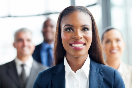 attractive afro american businesswoman and team looking up photo