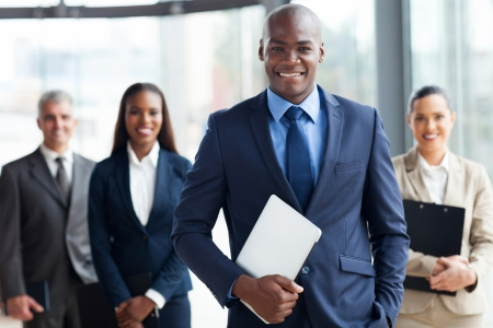 handsome African businessman with group of businesspeople Stock Photo