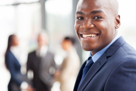 portrait of happy african businessman in office photo