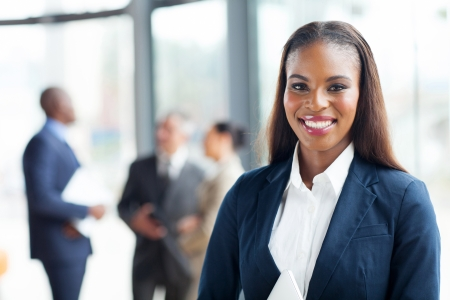 african american woman: close up portrait of happy african american businesswoman Stock Photo