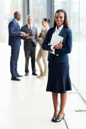 beautiful african businesswoman standing in modern office Stock Photo