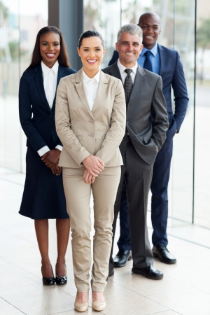 ethnic diversity: group of successful businesspeople standing in office