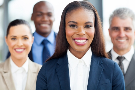 beautiful young african businesswoman with colleagues  photo