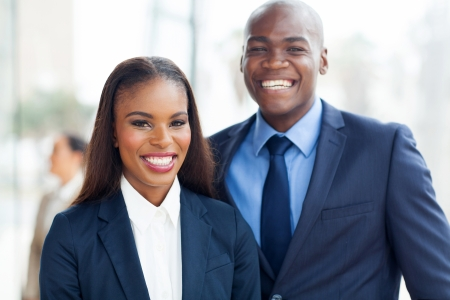 african american businesswoman: portrait of cheerful african business team Stock Photo