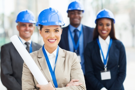 blue collar: beautiful young female architect with colleagues Stock Photo