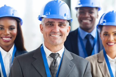 group of happy construction businesspeople in office photo