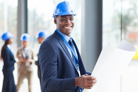 handsome african construction engineer with blue print photo