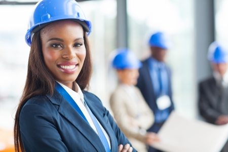 female engineer: pretty african american female construction worker in office Stock Photo