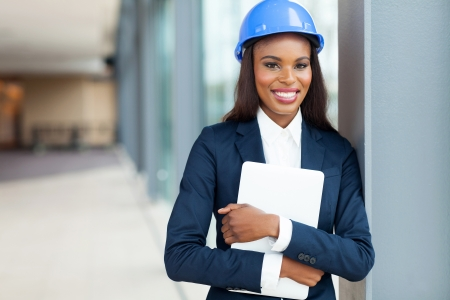 beautiful african construction engineer holding laptop computer photo