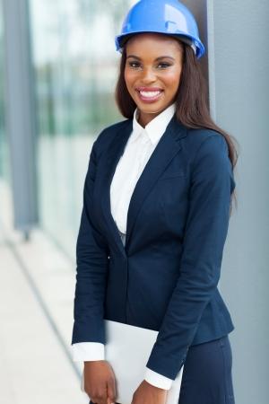 professional african female architect holding laptop computer Banco de Imagens