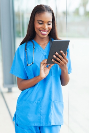 cheerful african doctor using tablet computer  photo