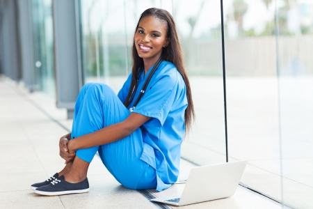 young african american doctor sitting at hospital floor photo