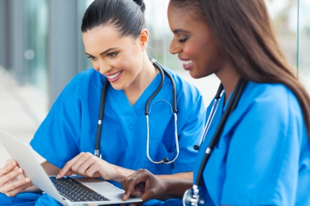 healthcare workers: happy healthcare workers using laptop