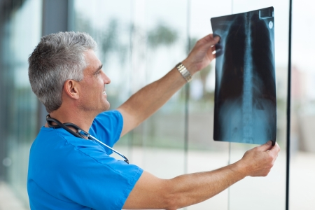 modern senior medical doctor holding patients x-ray photo