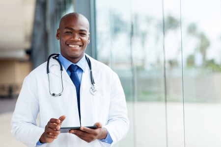 happy african male doctor with tablet computer photo