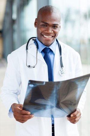 handsome african american healthcare worker with x-ray photo