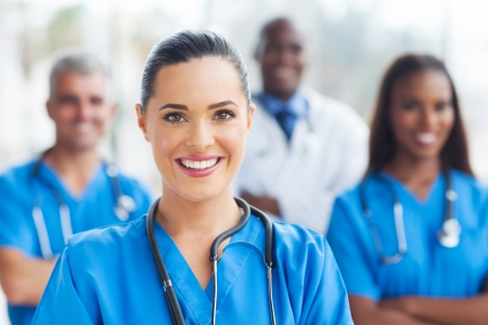 beautiful medical nurse and colleagues in hospital Banco de Imagens