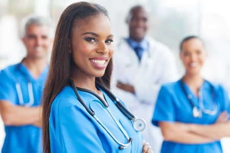 american health care: happy african female nurse with colleagues