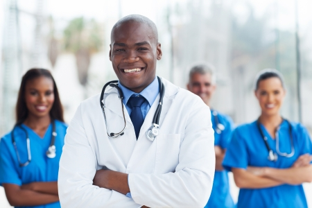 handsome african american medical doctor with colleagues photo