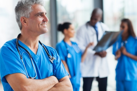 medical staff: portrait of confident senior medical doctor in hospital Stock Photo