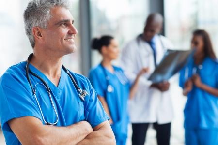 healthcare: portrait of confident senior medical doctor in hospital Stock Photo