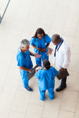 overhead view of medical workers having a meeting at hospital photo