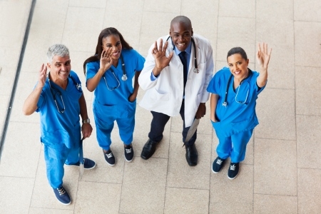 above view of medical doctors looking up and waving photo