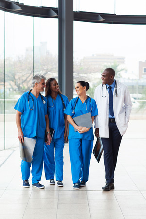 group of successful medical doctors walking in hospital photo