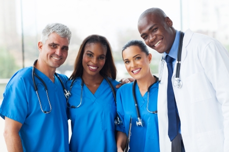 group of happy multiracial medical team in hospital photo