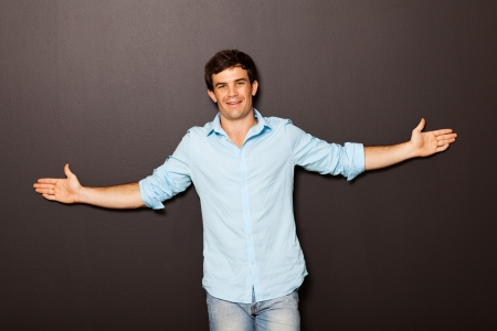 half open: cute man standing with arms open Stock Photo