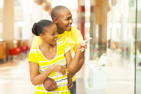 happy young african couple shopping in mall photo