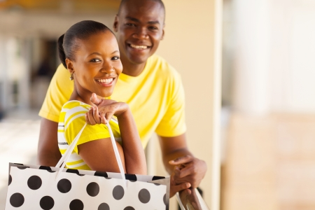beautiful couple: beautiful young african couple with shopping bag