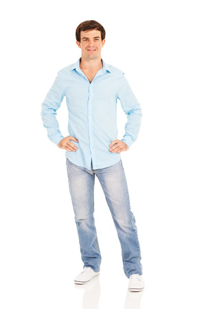 man in jeans: cute male model posing with hands on his hips isolated on white
