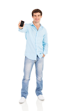 good looking man: good looking man showing his cell phone on white background