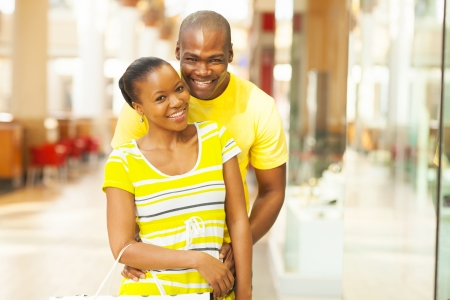 portrait of african american couple in shopping mall photo