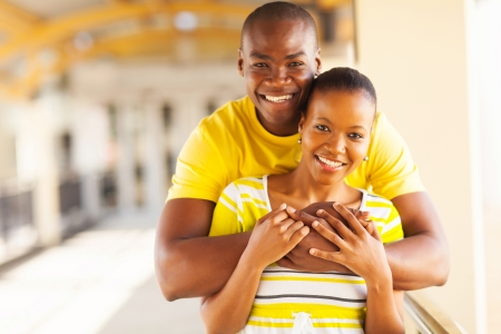 african boy: portrait of young african american couple hugging