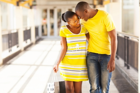 happy afro american couple flirting in shopping mall photo