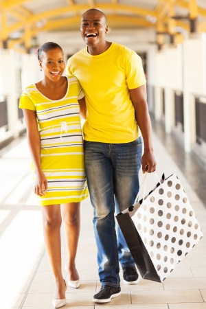 cheerful young african couple in shopping center photo