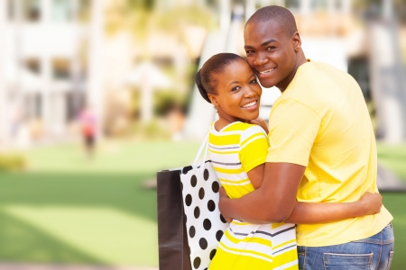 cheerful african american couple outside shopping mall photo