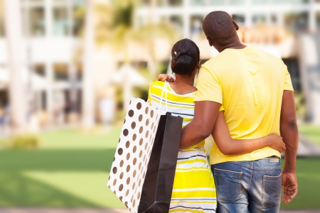 rear view of young african couple looking at modern apartment before buying photo