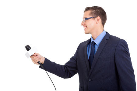 side view of journalist interviewing with microphone on white  photo