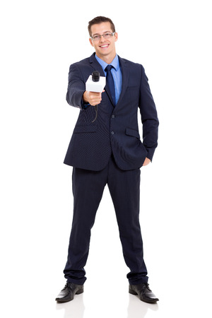 full length portrait of news reporter interviewing with microphone photo