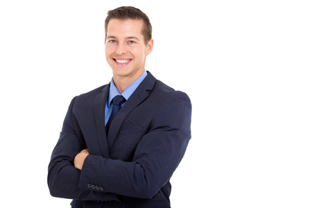 half dressed: happy young corporate worker with arms folded on white background Stock Photo