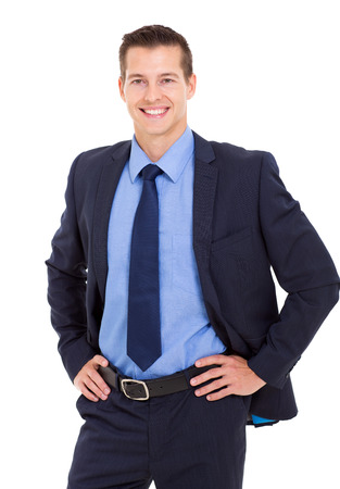 cheerful businessman hands on hip and looking at the camera