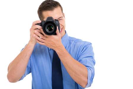 photographe m�le prenant la photo sur fond blanc photo