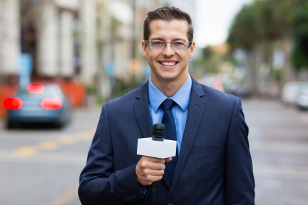 tv reporter: professional news reporter live broadcasting on urban street