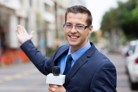 correspondent: happy news reporter in live broadcasting on street