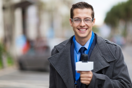 live work city: successful news reporter working in a cold weather outdoors Stock Photo