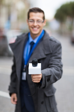 professional news reporter doing interview outdoors photo