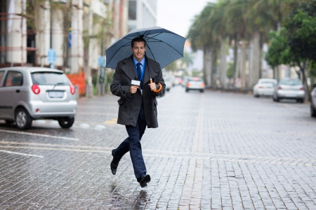good weather: young news correspondent rushing for breaking news in raining day